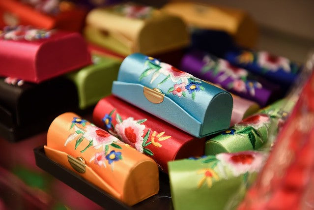 Satin lipstick cases with floral patterns