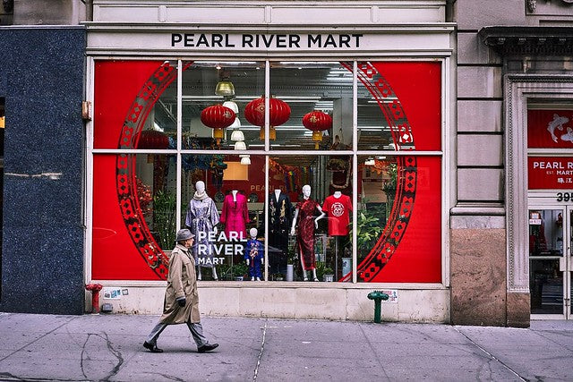 Exterior of Pearl River Mart flagship in Tribeca with man walking in front