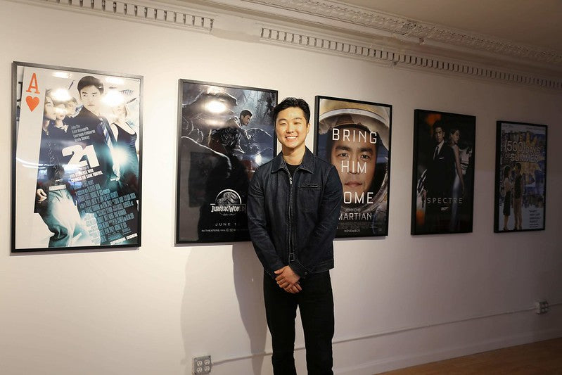 Artist-in-residence William Yu with posters from his exhibition