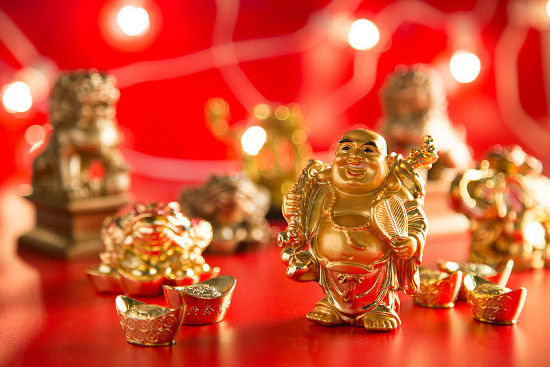 Beautiful gold figurines of Buddha, ingots, money toads, and fu dogs