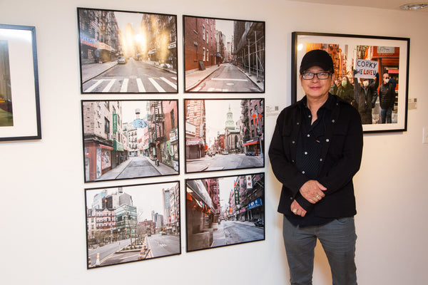 Photographer Wai Ng with his pictures
