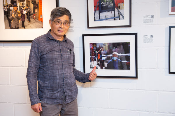 """Photographer Joseph Hsu with his work as part of """"Corky Lee on My Mind"""""""