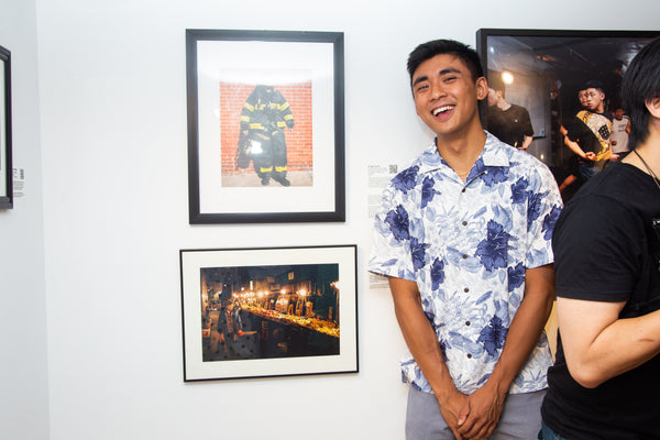 Photographer Kyle Lui with his photo