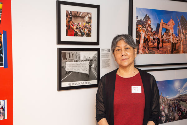 Photographer Tomie Arai with her pictures
