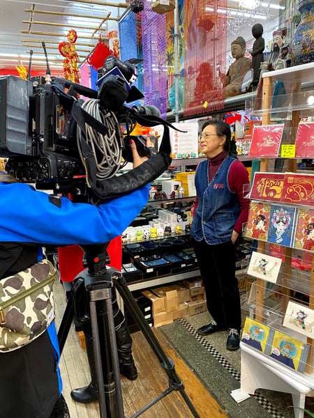 Mrs. Chen speaks with Cindy Hsu on camera in Pearl River's Tribeca store