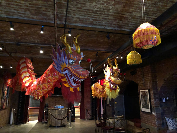 Large decorative dragons hanging for a birthday party