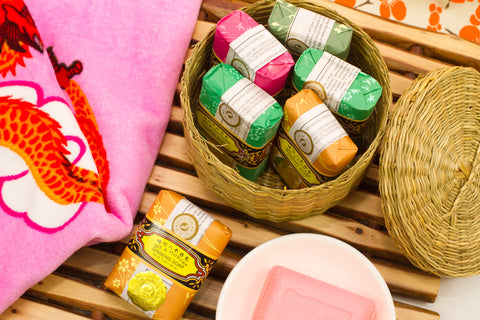 Beautiful display of Bee & Flower soap in basket with towel