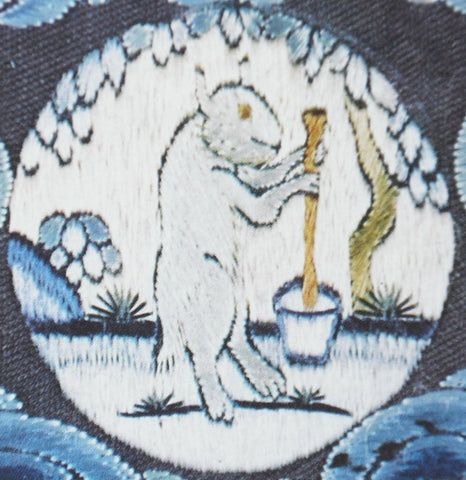 A cross-stitch of the jade rabbit with a mortar and pestle