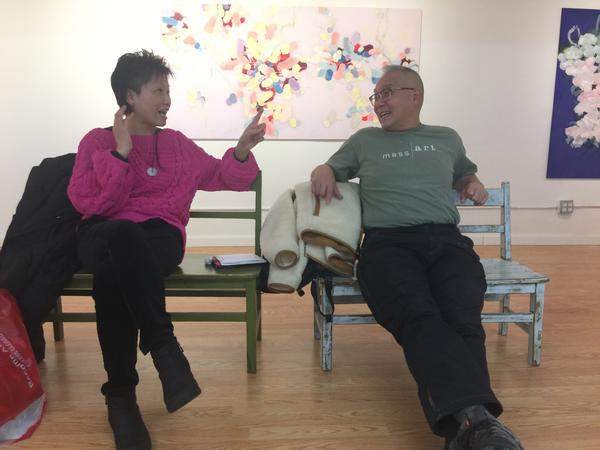 Mee Mee Chin and Arlan Huang chatting in Pearl River art gallery