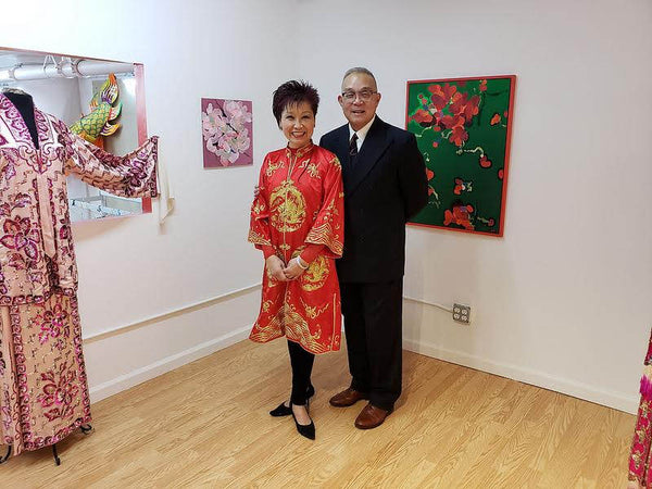Mee Mee Chin and Arlan Huang in the Pearl River art gallery during their opening reception