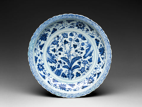 Blue and white plate with flowers, fruit, and rocks