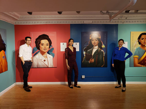Artist Bo Feng Lin, curator Kelly Lan, and Pearl River President Joanne Kwong in front of gorgeous paintings of important women in Asian American history