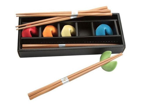 Set of colorful fortune cookie chopstick holders with bamboo chopsticks
