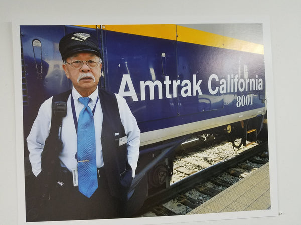 Asian American Amtrak conductor