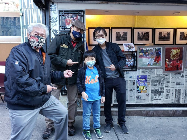 Corky Lee at his newsstand photo exhibit with Karlin Chan, Patrick Mock, and Griffin