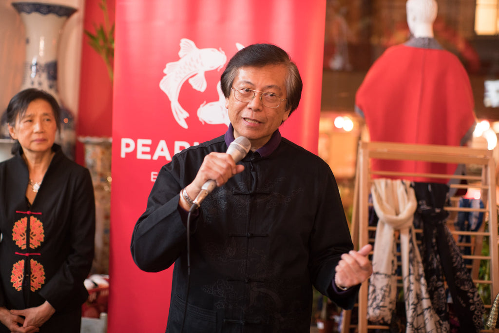 """Corky Lee at the opening of his art exhibition at Pearl River, """"Chinese America on My Mind"""""""