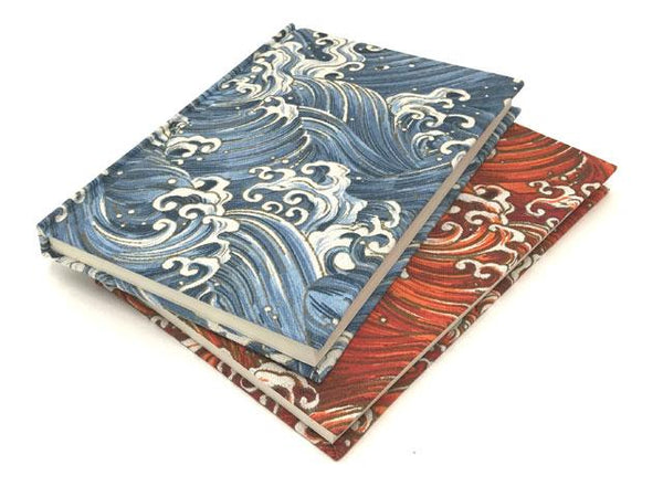 "Two notebooks with blue and red ""wave"" design"