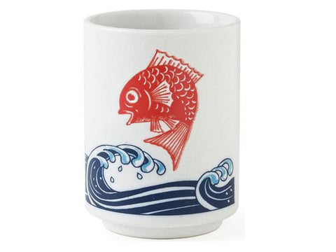 A ceramic tea cup with red snapper over a blue wave