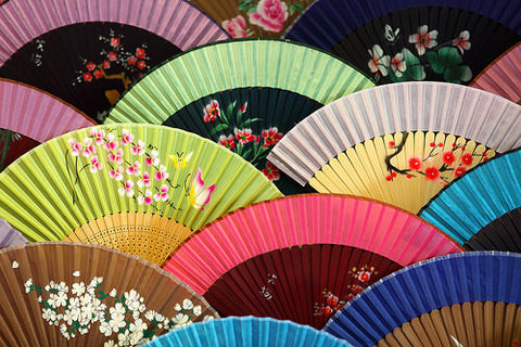 Arrangement of colorful folding fans