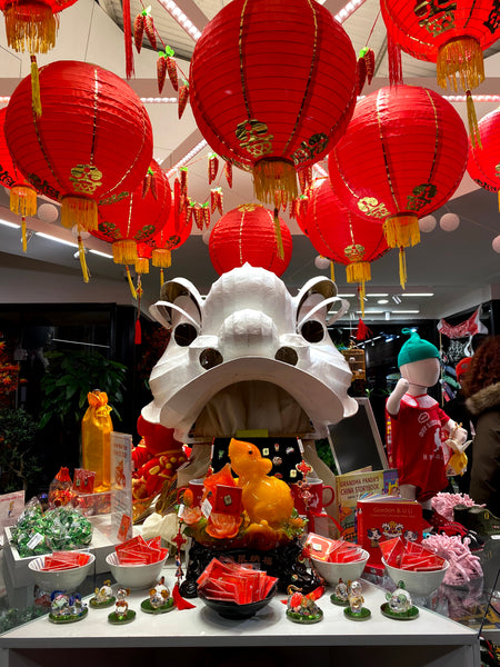 Pearl River Mart in-store display of lanterns, lion head, rat decorations, and more