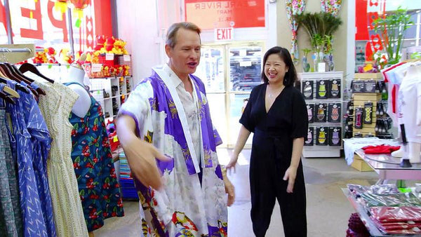 Celebrity fashion expert Carson Kressley with Pearl River president Joanne Kwong having fun in Pearl River's Tribeca store