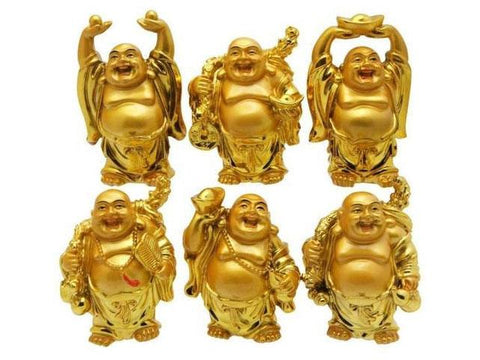 Six gold Buddha figurines in different positions