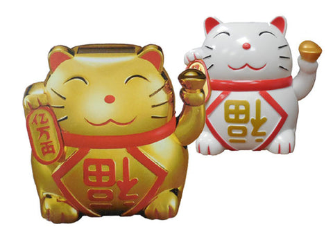 Two lucky cat figurines, one gold, one white