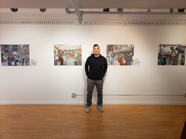 Artist Jerry Ma in front of some of his work in the Pearl River Mart art gallery