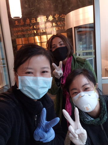 Joanne, Carlina, and Viv in front of Charles B. Wang health center sign