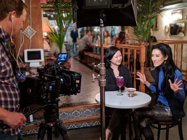 Joanne Kwong and TV host Kelly Choi filming a segment of Feed Me TV