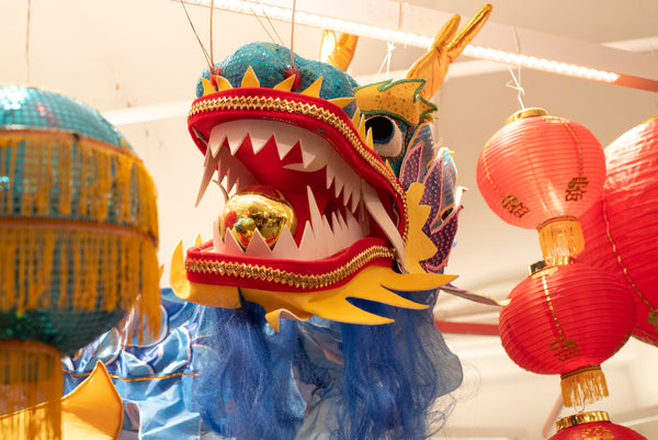 Close up of blue dragon decoration with gold ball in its mouth