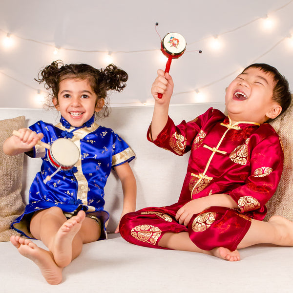 Children laugh and play in traditional Chinese clothes
