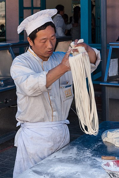 A man making lamian, or pulled noodles