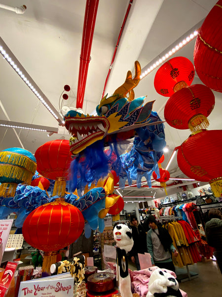 Pearl River Mart in-store display of blue dragon with lanterns and merchandise