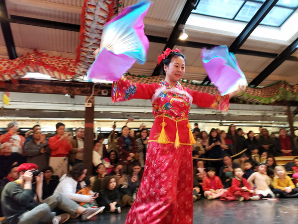 Dancer Ling Tang performing a fan dance at Pearl River Mart's Lunar New Year celebration at Chelsea Market