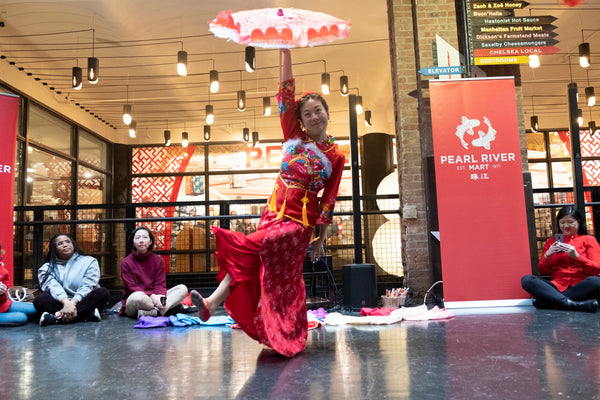 Dancer Ling Tang performing a parasol dance at Pearl River Mart's Lunar New Year celebration at Chelsea Market
