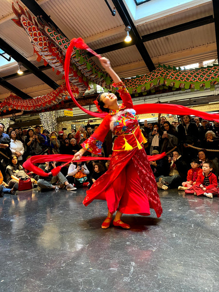 Dancer Ling Tang performing a ribbon dance at Pearl River Mart's Lunar New Year celebration at Chelsea Market