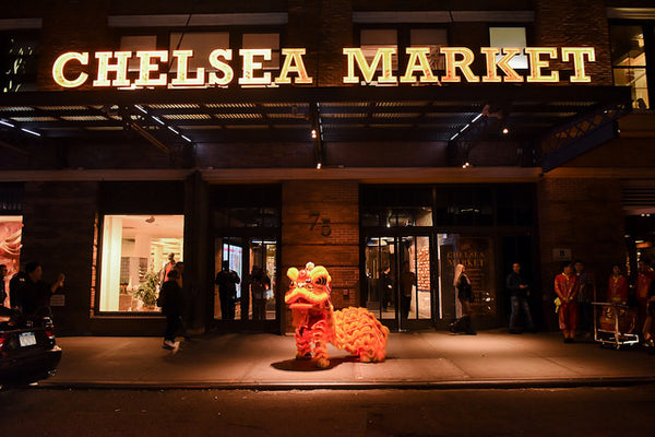 A glowing Chinese lion in front of Chelsea Market