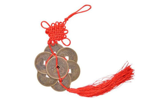 A lucky coin ornament with red tassels