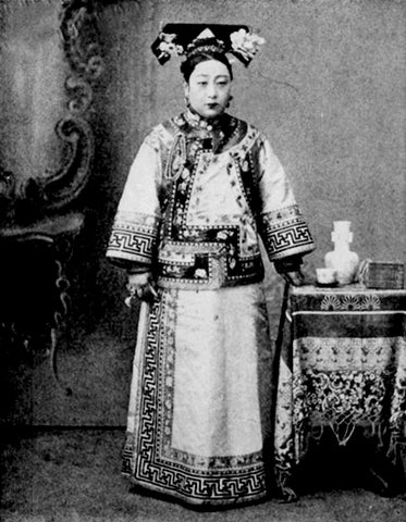 A woman wearing a 19th-century Manchu-style qipao