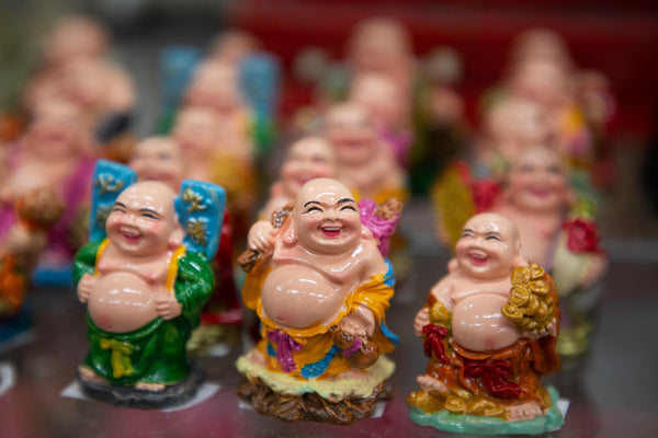 Rows of miniature laughing Budai figurines