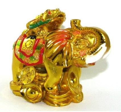 Gold colored money toad atop an elephant