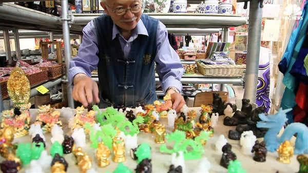 Mr. Chen arranging Buddha figurines