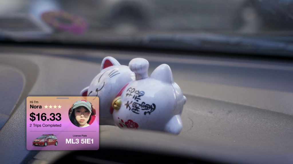 White lucky cat on dashboard