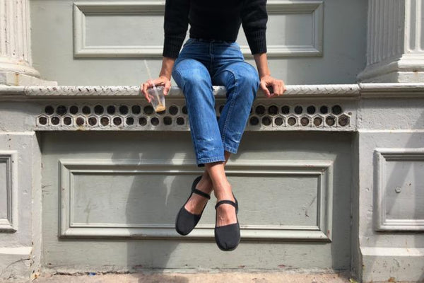 Woman wearing black mary jane shoes