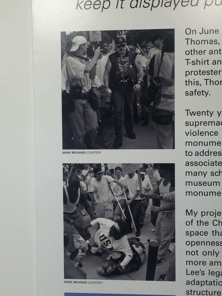 Close up of photos on explanatory board of Monument to Keshia Thomas