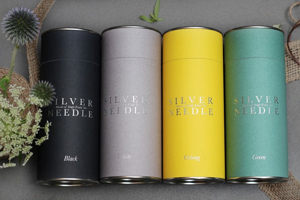 Canisters of Silver Needle Tea Company artisan tea leaves