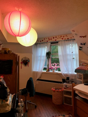 Skye's dorm room lit up with two large paper lanterns