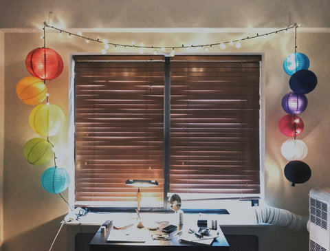 Colorful lanterns and string lights around a window