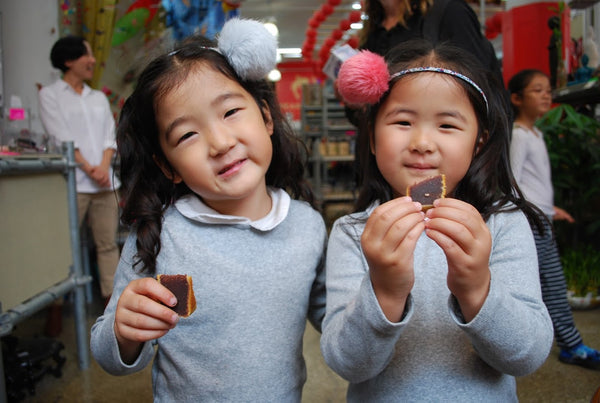 Twin girls enjoying mooncakes